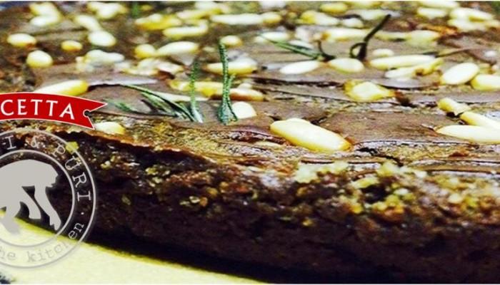 Castagnaccio: dolce di farina di castagne, con noci pinoli uvetta e rosmarino.